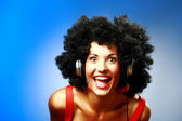 Happy woman with afro hairstyle wear headphones — Stock Photo