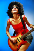 Sensual woman playing on the electric guitar — Stock Photo