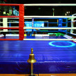 Empty boxing ring and bell — Stock Photo