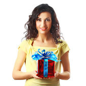 Beautiful brunette woman holding a gift. Isolated on white background. — Stock Photo