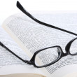 Spectacles lying on the opened book — Stock Photo