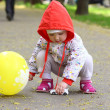 Baby with the toy and baloon — Stock Photo #13937726