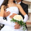 Embracing bride and groom — Stock Photo
