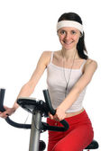 Happy young woman on a training bicycle — Stock Photo
