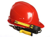 Construction equipment helmet, tape line and snips — Stock Photo