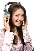 Attractive smiling young woman with headphones — Stock Photo