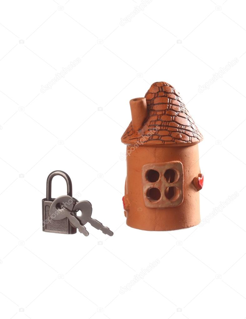 Clay house and padlock with keys isolated on white — Stock Photo #13937919