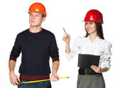 Two young in hardhats discussing construction process — Stock Photo