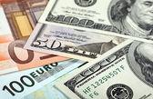 Money: euro and dollar banknotes — Stock Photo