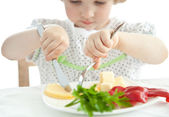 Little girl eating her dinner — Stock Photo