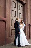 Bride and groom looking at each other — Stock Photo