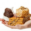 Hands holding delicious sweet cakes — Stockfoto