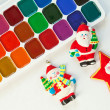 Colorful paints set and new year toys — Stock Photo #14774779