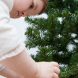 Little girl decorating a Christmas tree — Stok fotoğraf