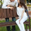 Romantic couple on the bench — Stock Photo