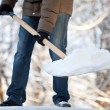 Man removing snow from a driveway — Stock Photo