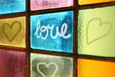Love message painted on window — Stock Photo