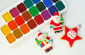 Colorful paints set and new year toys — Stock Photo