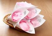 Wedding rose petals in basket — Stock Photo