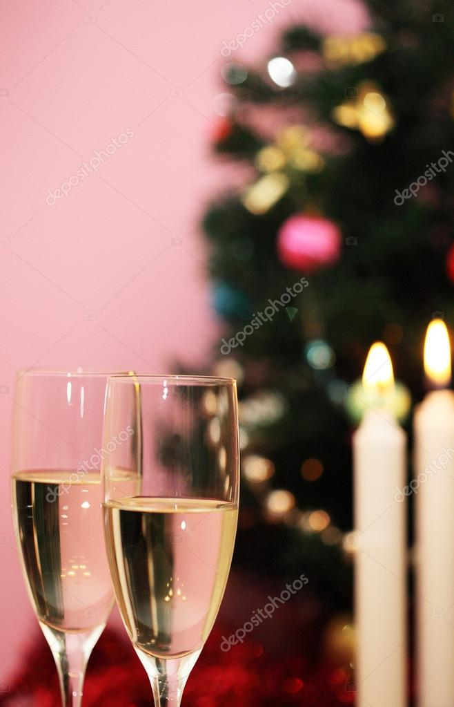 Christmas tree, candles and two glasses of champagne — Stock Photo #14774415