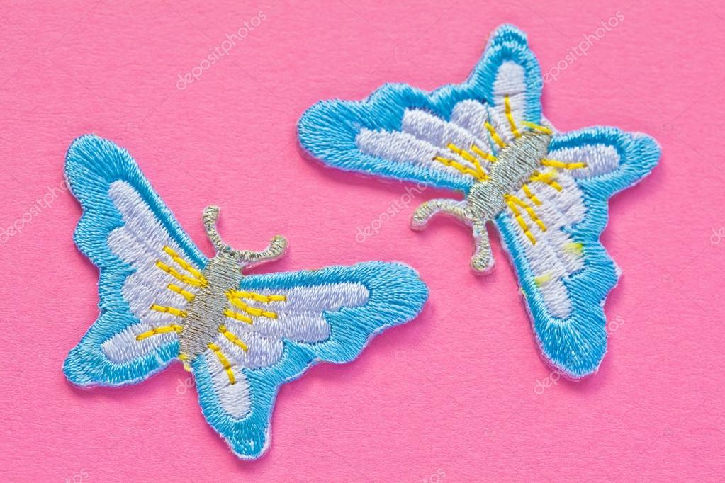 Artificial handmade butterflies on pink background  Stock Photo #14775183