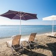 Beach chairs and umbrellas — Stock Photo #14827929