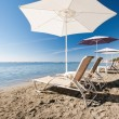 Beach chairs and umbrellas — Stock Photo