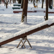 Empty swing in winter time — Stock Photo