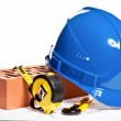 Construction tools, hardhat, brick and blueprint — Stock Photo #14997303