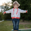 Little girl in a summer park — Stock fotografie