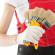 Construction worker in uniform with brushes - Stock Photo