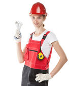 Construction worker in uniform with tools isolated on white — Stock Photo