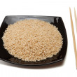 Rice in bowl and chopsticks — Stock Photo