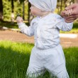 Baby girl in a summer park — Stock Photo #17685493