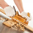 Working with wood plane - Stock Photo
