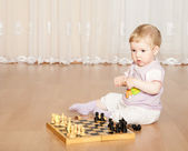 Baby girl playing chess — Stock Photo