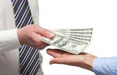 Human hands exchanging money — Stock Photo