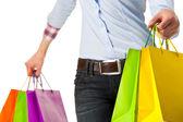 Vrouw met veelkleurige winkelen papieren zakken — Stockfoto