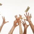 Many hands competing for money — Stock Photo