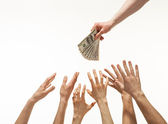 Many hands reaching out for money — Stock Photo