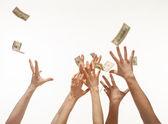 Muchas manos compitiendo por dinero — Foto de Stock
