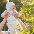 Baby girl in a summer park — Stock Photo
