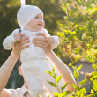Baby girl in a summer park — Stock Photo #19932981