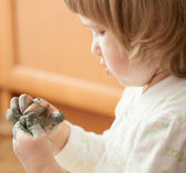 Little girl modelling clay toy — Stock Photo
