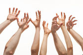 Many hands reaching out up — Stock Photo
