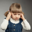 Little girl covers her ears — Stock Photo