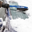 Removing snow from car — Stock Photo