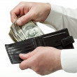 Man's hands holding leather wallet with dollars — Stock Photo