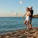 Happy young couple having fun at sunny beach — Stock Photo #21179581