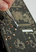 Process of repairing computer electronic board — Stock Photo